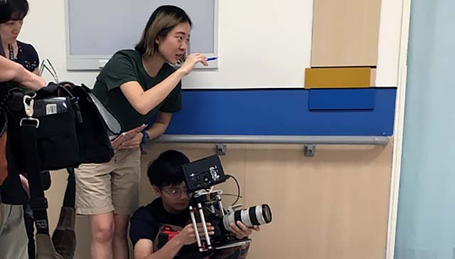 Christine directing camera man