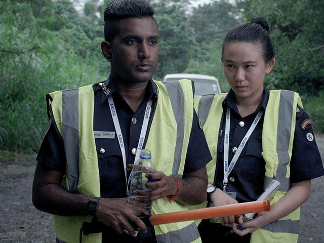 A still from Breakdown with Inspector Ong (Low Yeujia) and Lance Corporal Gamesh (Hari Kishan).jpg