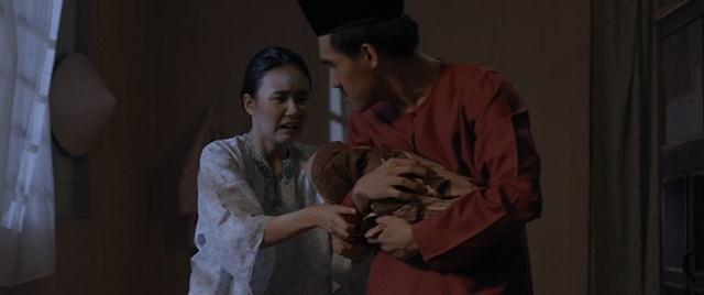Siti (young siti played by Syukii Wan) had her infant son Joshua taken from her - a still from Separation (Perpisahan)-5d78e70d.jpg