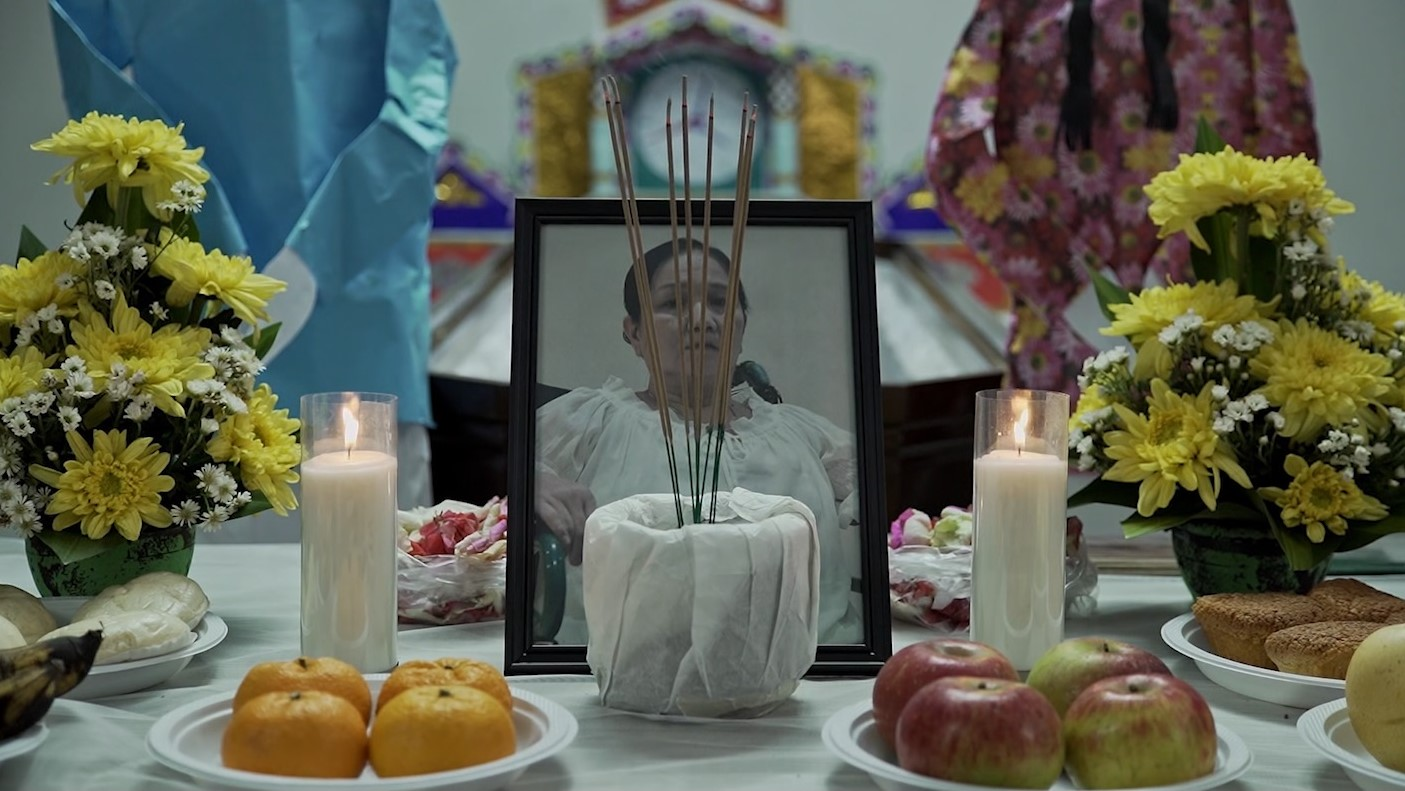 A still from 'Mother' on the funeral scene